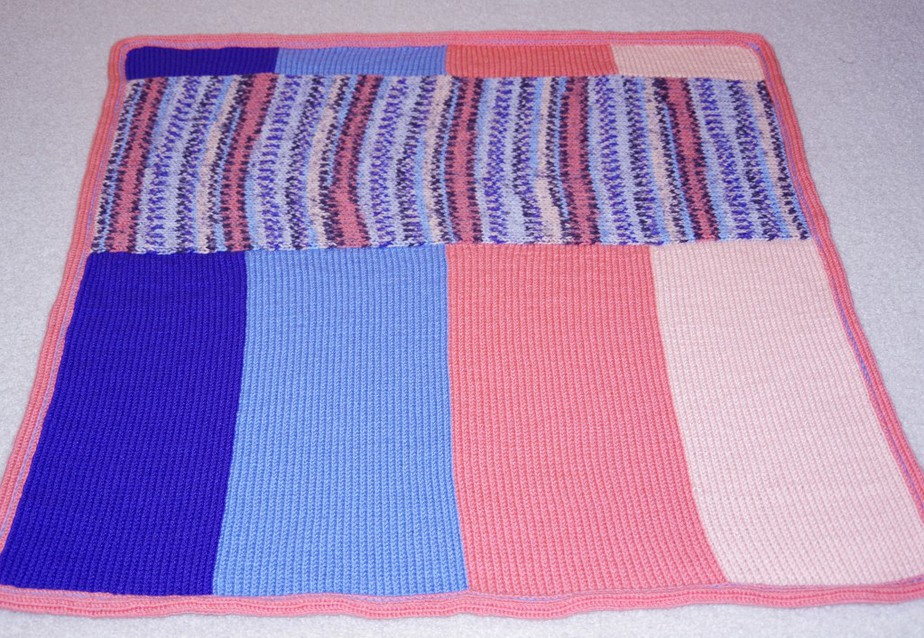 Quick and Easy project for Addi Kingsize Knitting Machine.  This could be a great last minute baby gift!