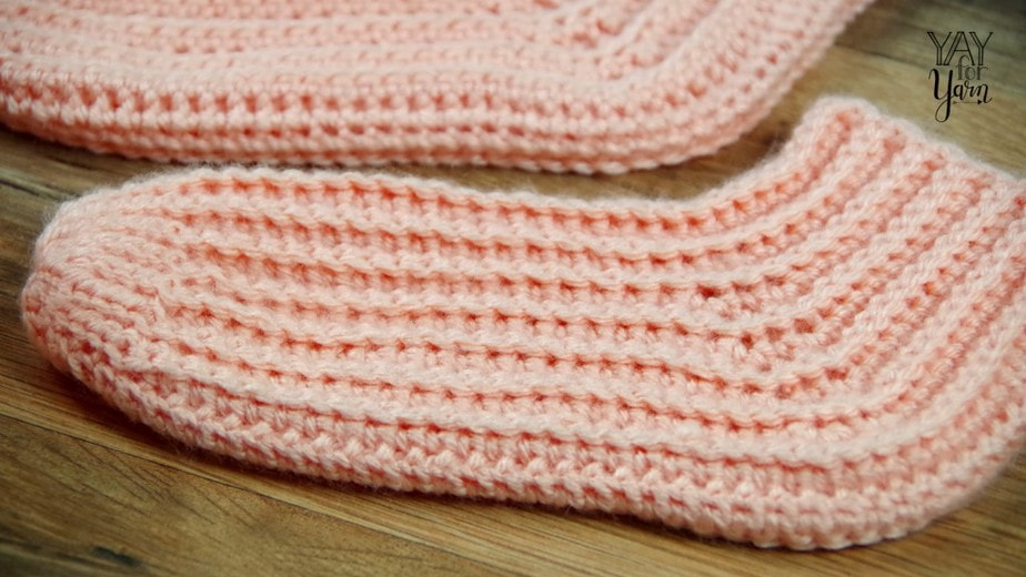 Worked sideways in rows for extra stretch and comfort, these simple crochet socks will keep your toes toasty warm.