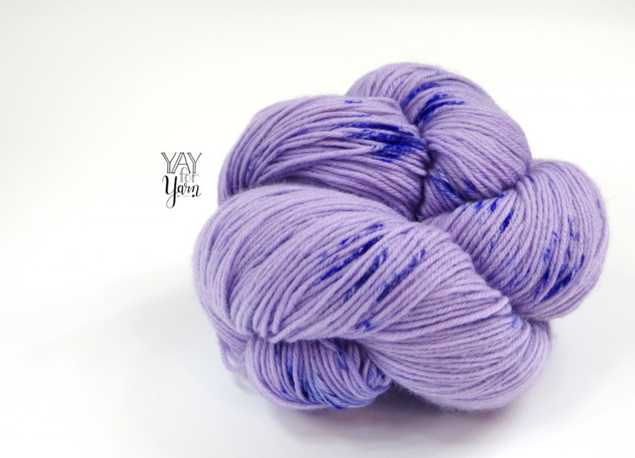 Purple hand-dyed fingering weight yarn with royal blue speckles