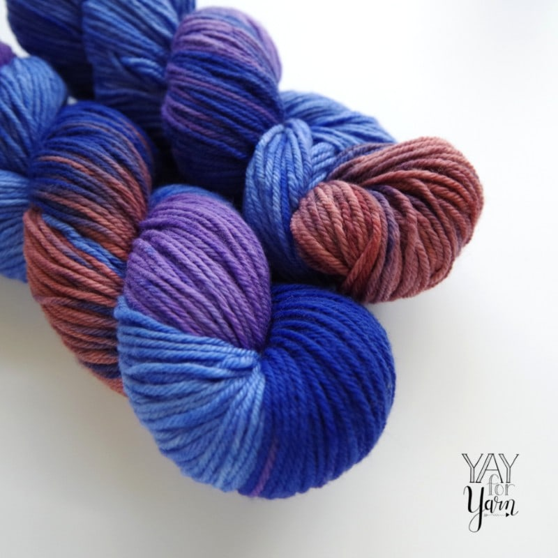 two skeins of blue purple copper hand dyed yarn
