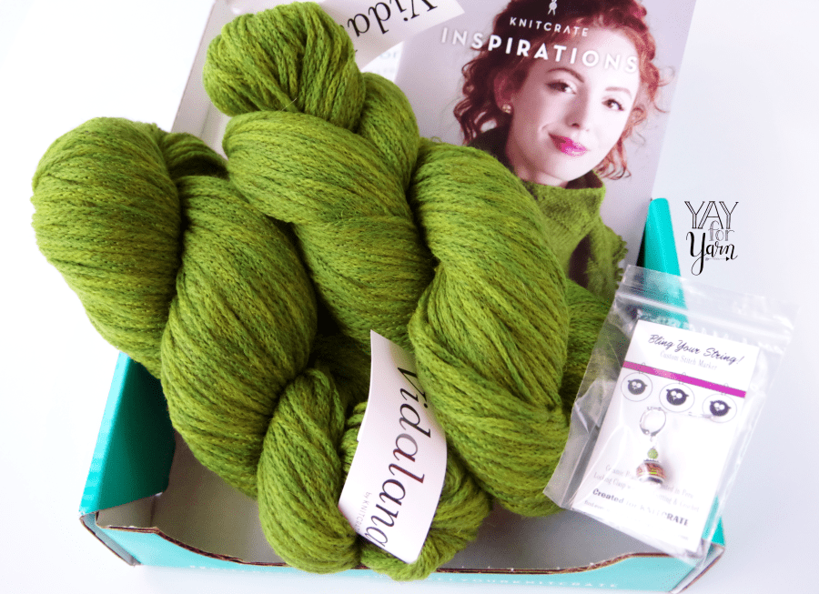 Coupon Code for luxury yarn subscription - green hand dyed chainette yarn in box with stitch marker and pattern booklet