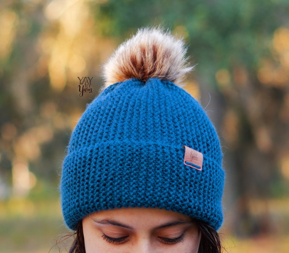 blue knitted hat for beginner from worsted weight yarn