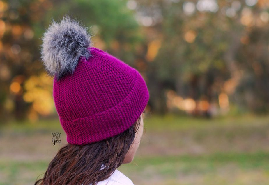 side view, burgundy purple toque beanie hat with pom pom