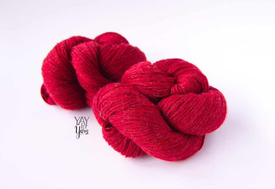 two twisted skeins of red yarn