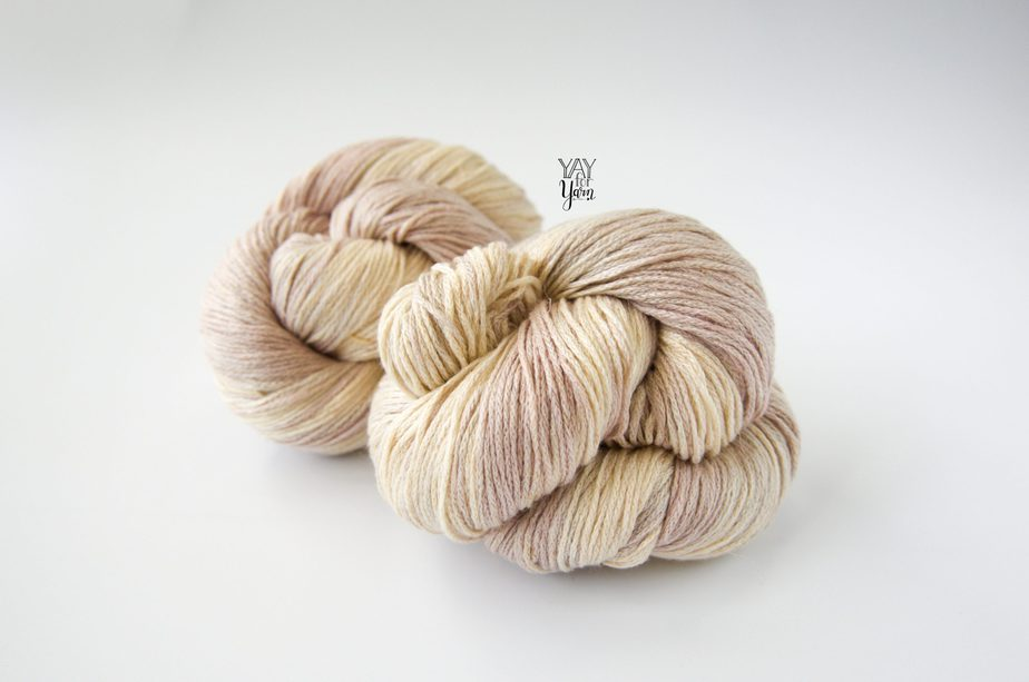 two twisted skeins of beige hand dyed yarn