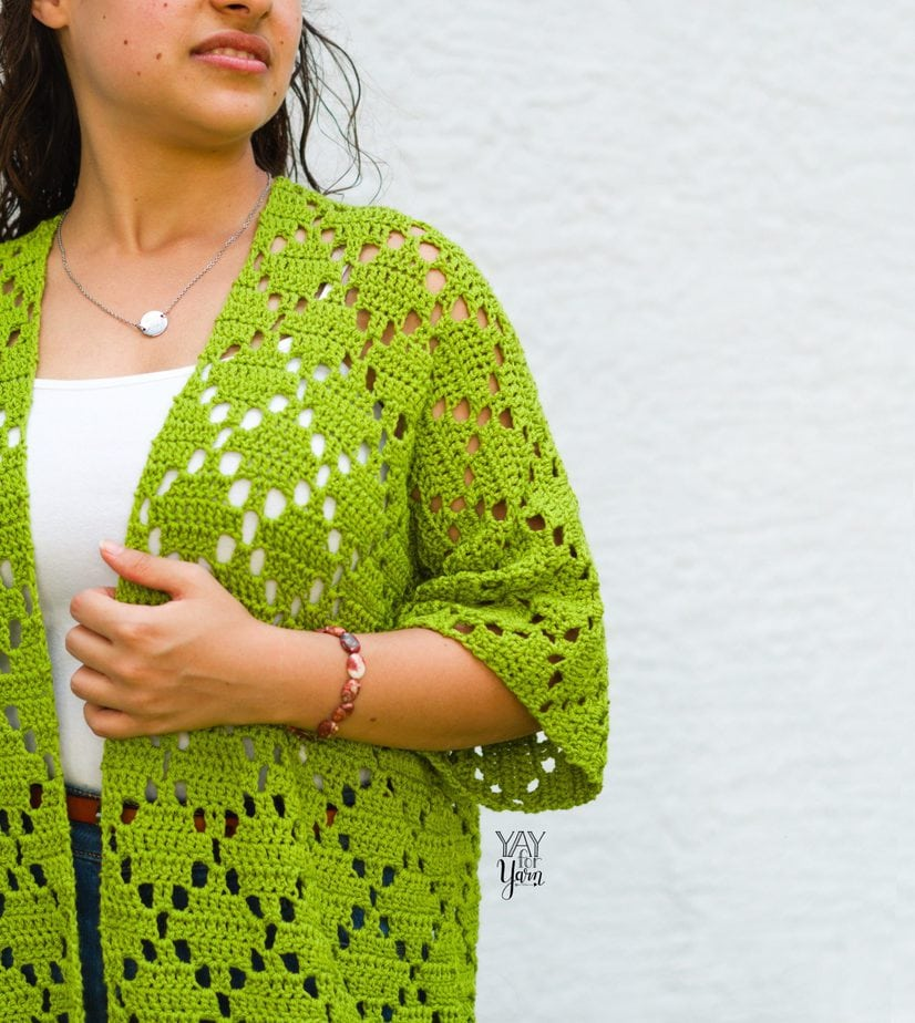 closeup of lime green cardigan with white tank