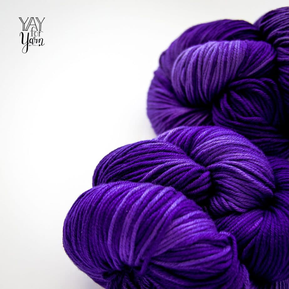 pile of navy blue tonal hand dyed pima cotton yarn from july 2020 knitcrate