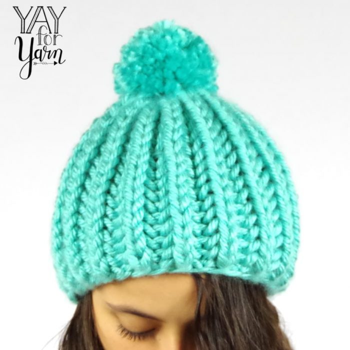 If you can knit and purl, you can make this Chunky Brioche Pom Pom Hat!