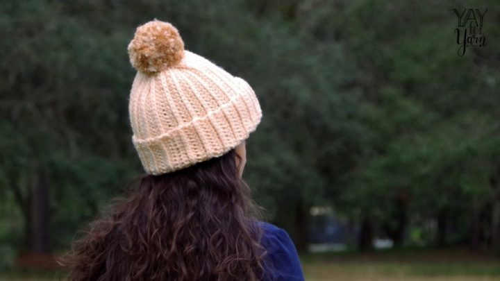 This Crochet hat uses a simple stitch that looks like knitting, and the whole hat can be made in less than 2 hours!  FREE Crochet Pattern